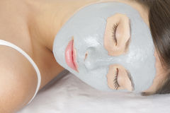 Woman with facial mask. Portrait of woman with facial mask Stock Photos
