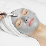 Woman with facial mask. Portrait of young woman with facial mask Royalty Free Stock Photo