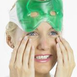 Woman with facial mask Stock Image