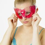 Woman with facial mask Stock Photos