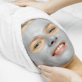 Woman with facial mask. Portrait of young woman with facial mask Stock Photography