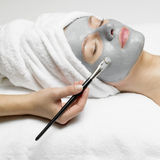 Woman with facial mask. Portrait of young woman with facial mask Royalty Free Stock Photography