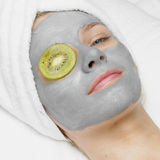 Woman with facial mask Stock Photo