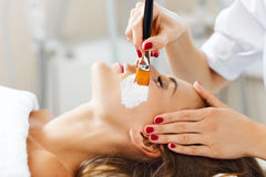 Woman with facial mask in beauty salon Stock Photos