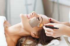 Woman with facial mask in beauty salon Royalty Free Stock Images