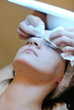 Woman with facial mask in cosmetic studio Stock Images