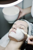 Woman with facial mask in cosmetic studio Stock Image