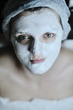 Woman with facial mask in cosmetic studio Stock Photography