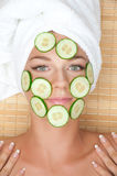 Woman with facial mask of cucumber Stock Photos