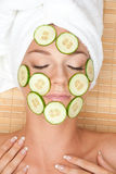 Woman with facial mask of cucumber Royalty Free Stock Images