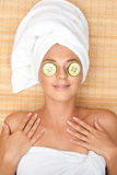 Woman with facial mask of cucumber Royalty Free Stock Photos