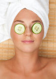 Woman with facial mask of cucumber Royalty Free Stock Image