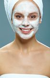 Woman with facial mask Royalty Free Stock Image