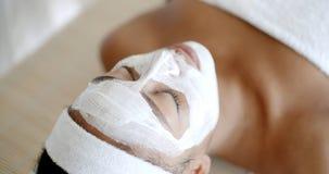 Woman With Facial Mask At Salon Royalty Free Stock Photos