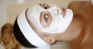 Woman With Facial Mask At Salon Royalty Free Stock Image