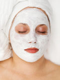Woman with facial mask. Shot from above Stock Photos