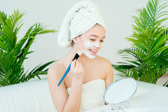Woman with facial mask. Young beautiful woman with facial mask, spa treatment Royalty Free Stock Images
