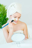 Woman with facial mask. Young beautiful woman with facial mask, spa treatment Stock Image
