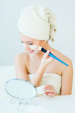 Woman with facial mask. Young beautiful woman with facial mask, spa treatment Royalty Free Stock Photos