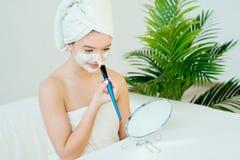 Woman with facial mask. Young beautiful woman with facial mask, spa treatment Stock Photos