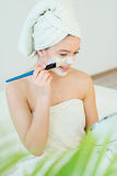 Woman with facial mask. Young beautiful woman with facial mask, spa treatment Royalty Free Stock Photo