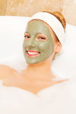 Woman with facial mud mask. Dayspa Royalty Free Stock Photos
