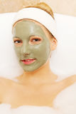 Woman with facial mud mask. Dayspa Royalty Free Stock Image