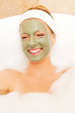Woman with facial mud mask. Dayspa Royalty Free Stock Photo