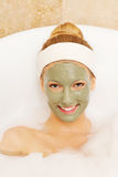 Woman with facial mud mask. Dayspa Stock Image