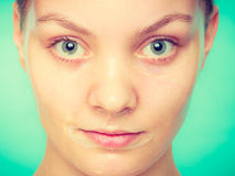 Woman in facial peel off mask. Royalty Free Stock Photography