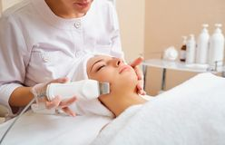 Woman on facial skincare procedure.r. Hardware cosmetology Stock Images