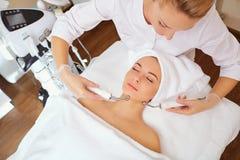 Woman on facial skincare procedure.r. Hardware cosmetology Stock Image