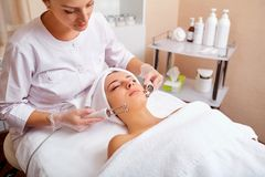 Woman on facial skincare procedure.r. Hardware cosmetology Royalty Free Stock Photography