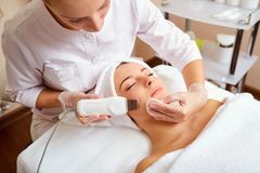Woman on facial skincare procedure.r. Hardware cosmetology Stock Photography