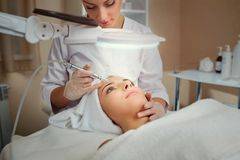Woman on facial skincare procedure.r. Hardware cosmetology Royalty Free Stock Photo