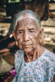 Woman with facial tattoos in Myanmar. Kyee Chaung, Myanmar - May 30, 2016: Portrait of old woman with facial tattoos in Chin villages, Mrauk U region stock image
