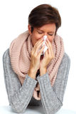Woman with facial tissue having flu. Royalty Free Stock Images