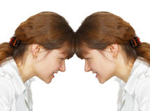 Woman facing her forehead with herself. A woman facing her forehead with herself isolated on white background Stock Photos