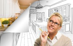 Woman Facing Kitchen Drawing Page Corner Flipping with Photo Behind. Her stock image