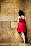 Woman facing stonewall Stock Images