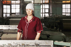 Woman at the factory Stock Images