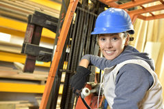 Woman factory operator in warehouse Stock Photos