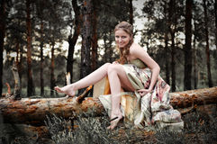 Woman in fairy forest. Portrait of romantic woman in fairy forest Royalty Free Stock Images