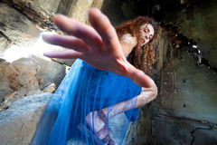 Woman fairy reaching hand. Woman with white body henna in abandoned building, reaching down to the camera Royalty Free Stock Photos