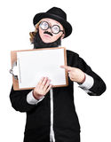 Woman With Fake Beard And Mustache Pointing On Clipboard Royalty Free Stock Photo