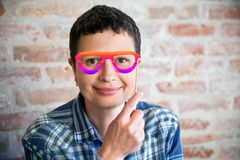 Woman with fake eyeglasses. Smiling woman with fake colored eyeglasses Stock Photos