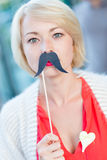 Woman with fake mustache. Stock Images