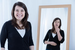 Woman with fake smile Royalty Free Stock Image