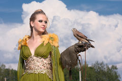 The woman with falcon Royalty Free Stock Photography