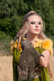 The woman with falcon Stock Photography